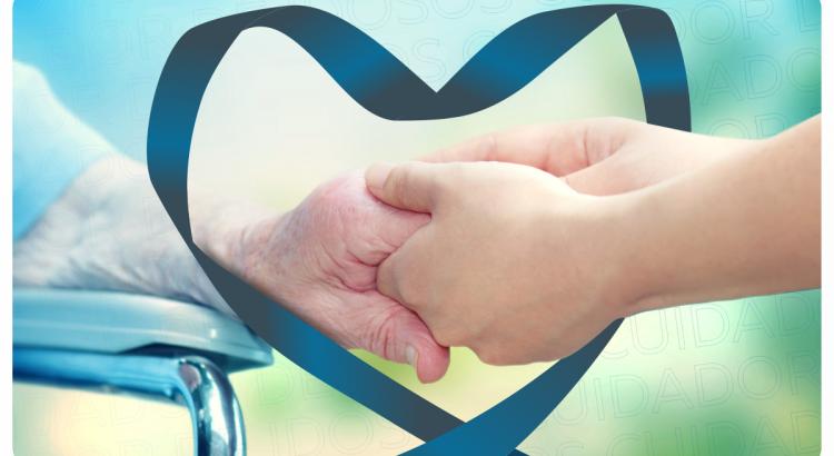 Cuidador de idosos segurando a mão do paciente